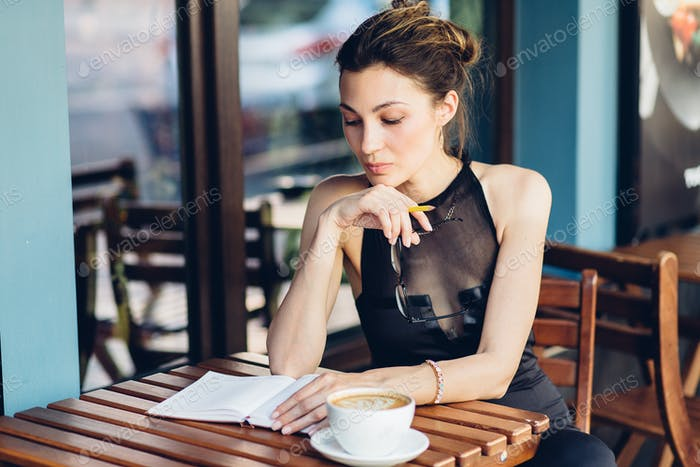Attractive girl with a notepad