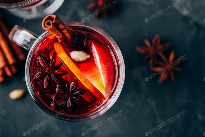 Christmas Mulled Wine with spices and fruits on a dark background, copy space.