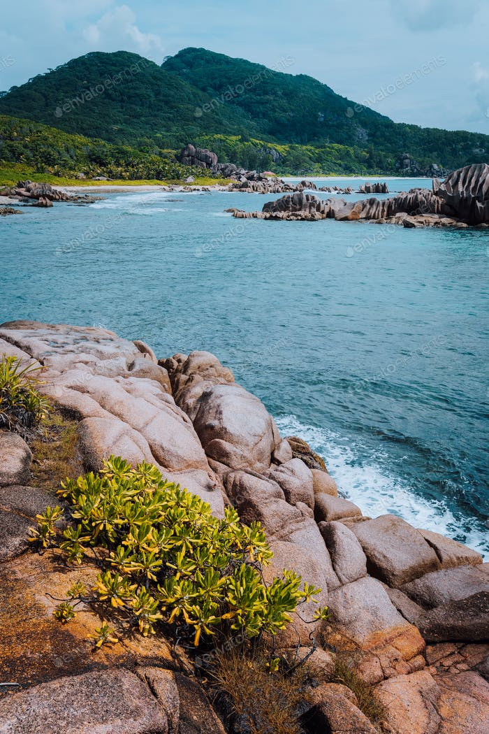 Uniquely natural seascape of La Digue island at Seychelles. Secluded remote beach with granite rocks