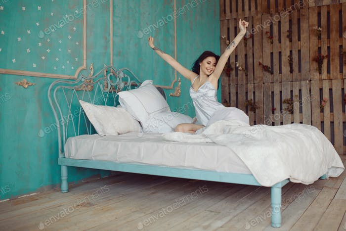 Woman stretching in bed after wake up