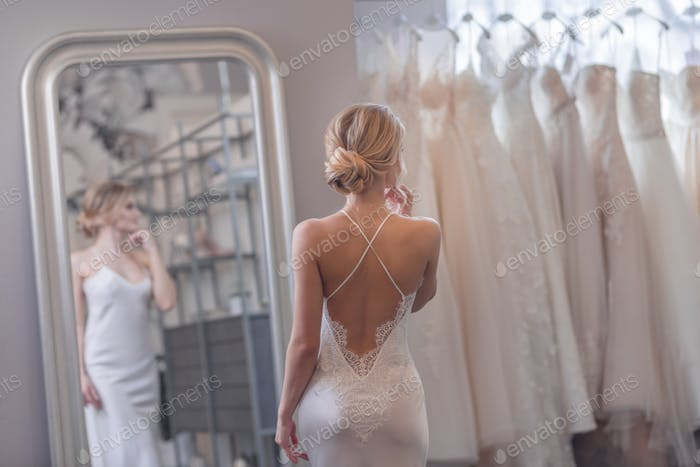 Attractive girl in a wedding shop