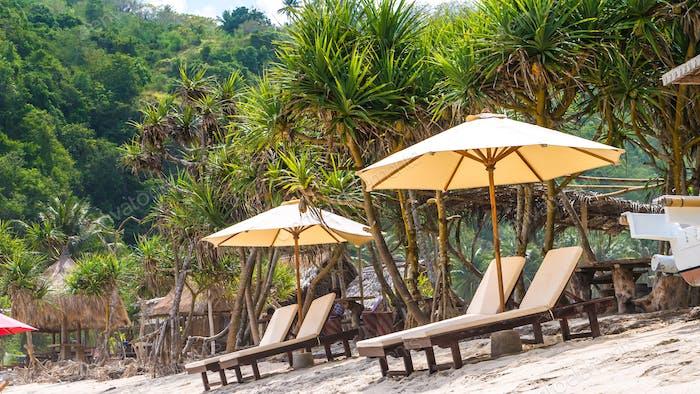 Sunbed on White Sand under Palms - Atuh Beach, Nusa Penida, Bali, Indonesia