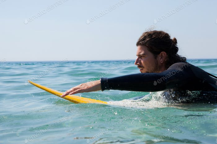 Surfer surfboarding in the sea