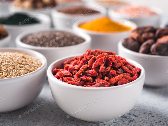 Goji berries in small white bowl and other superfoods