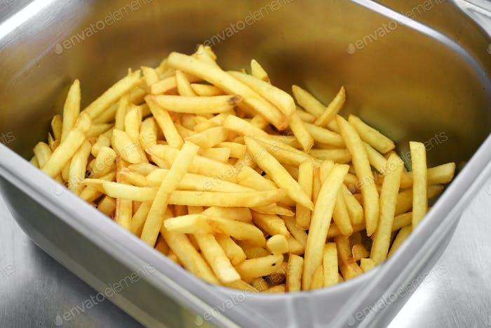 Metal bin filled with golden crispy potato chips
