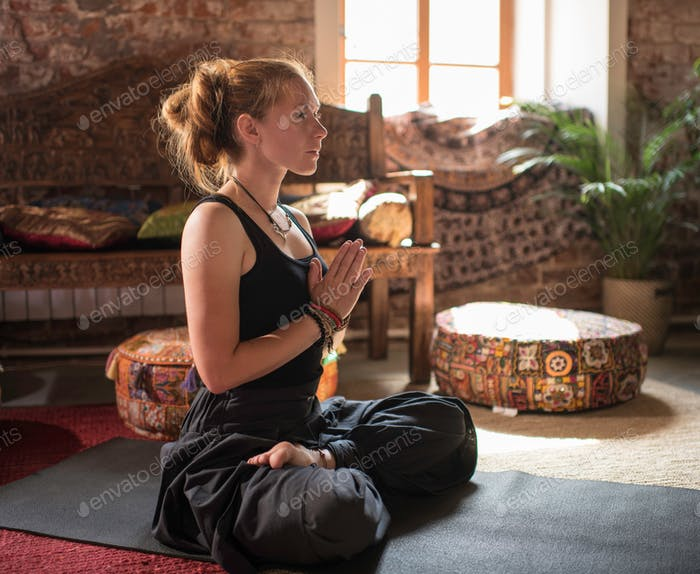 Woman Sitting in a Meditation Pose