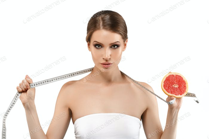 Beauty woman with orange citrus grapefruit with healthy skin body. Attractive fresh vitamin power