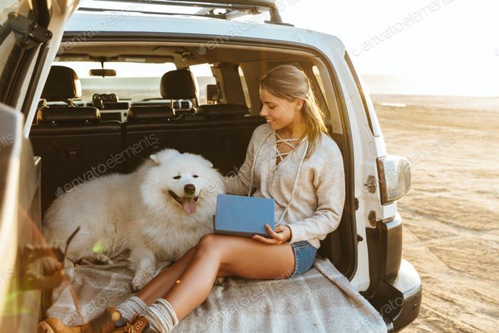 Woman with dog samoyed outdoors