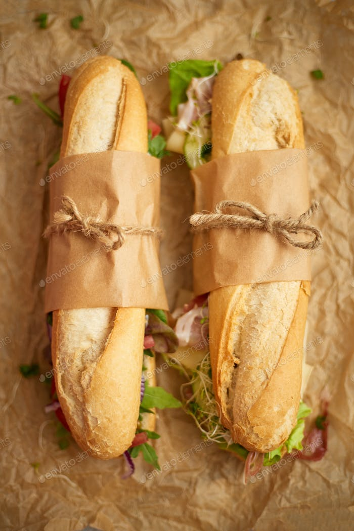 Tasty homemade sandwiches Baguettes with various healthy ingredients. Breakfast take away concept