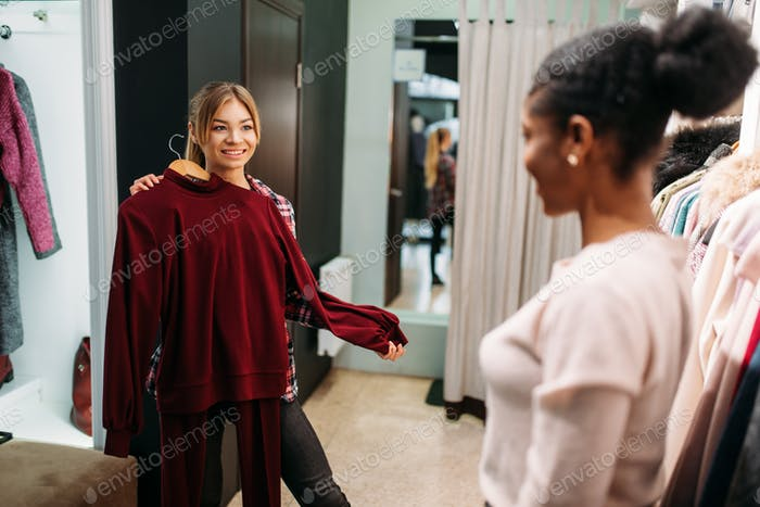Two women choosing clothes, shopping
