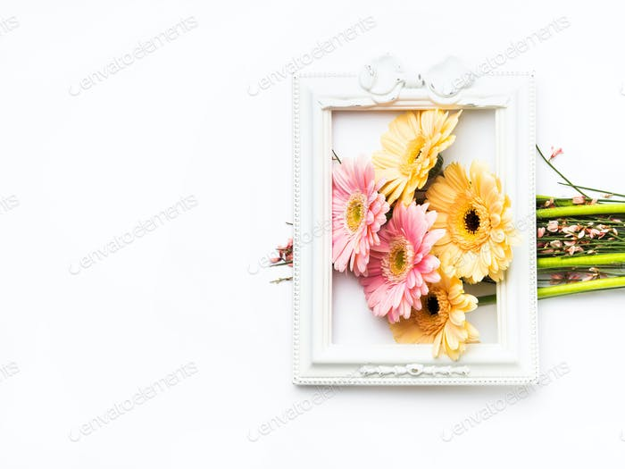 Beautiful gerbera bouquet in frame on white