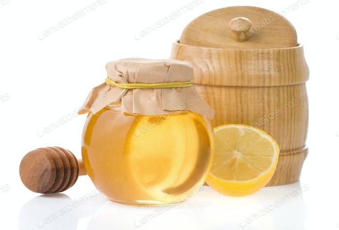 jar of honey and lemon isolated on white