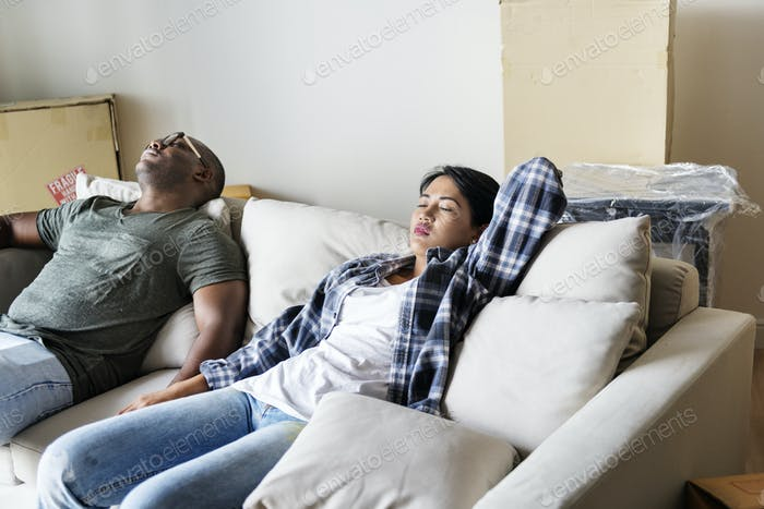 Couple relax after moved in to new house