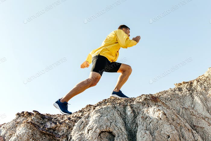 man climb uphill mountain