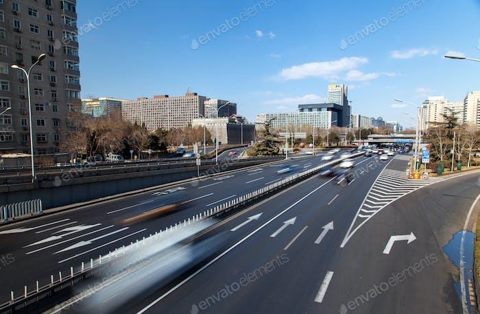 Chinese multi-lane highway at Beijing buildings