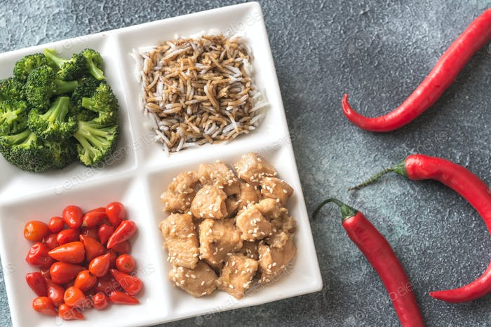 Bowl of broccoli and chili stir-fry on gray background