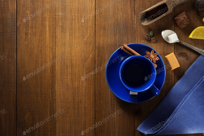 empty cup of coffee on wood