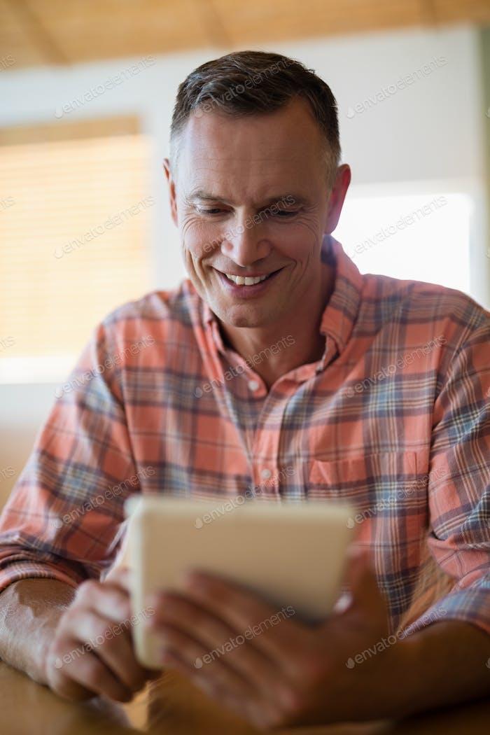 Man using digital tablet in restaurant