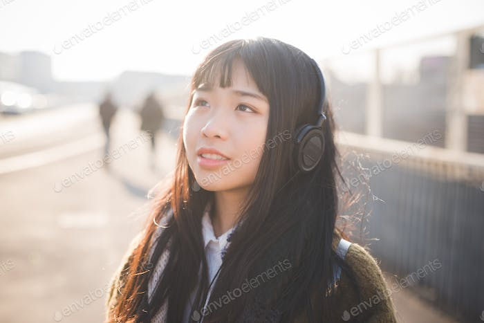 young beautiful asian hipster woman