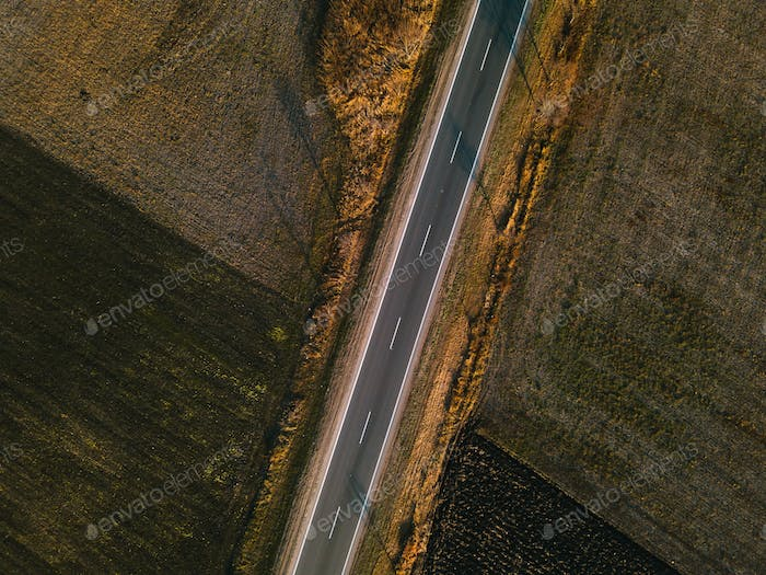 Aerial view of empty road through countryside