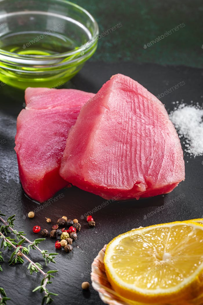 Raw tuna steaks with ingredients