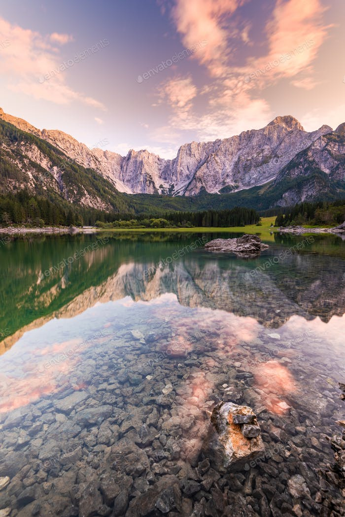 Mountains Reflection in Clear Fusine Lake Water at Beautiful Sun