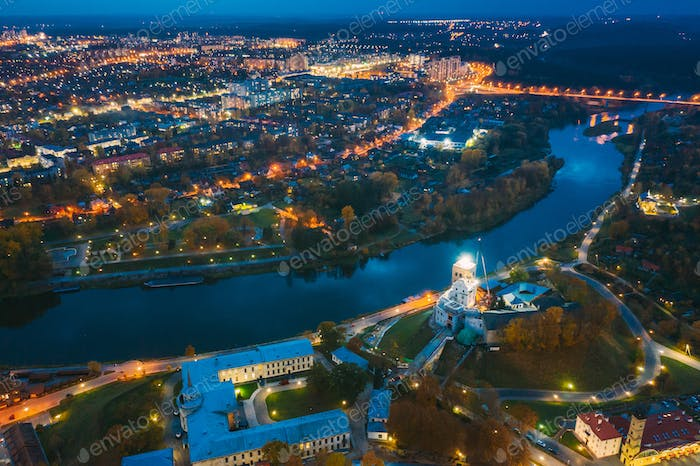 Grodno, Belarus. Night Aerial View Of Hrodna Cityscape Skyline. Popular Famous Historic Landmarks In