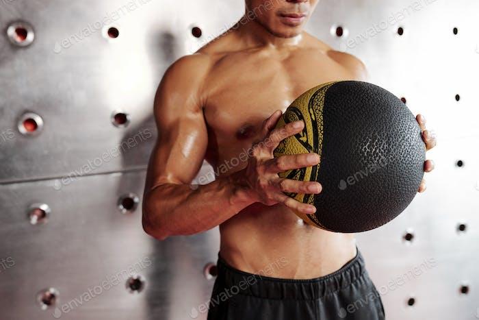 Sportsman with medicine ball