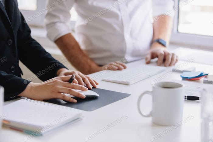 Two business associates working together at office desk
