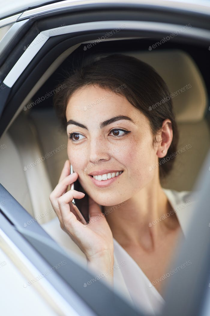 Young Woman Calling from Taxi