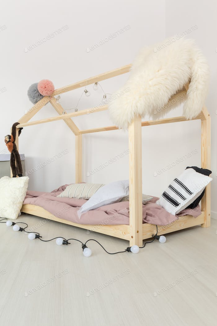 Baby bedroom with fluffy textiles