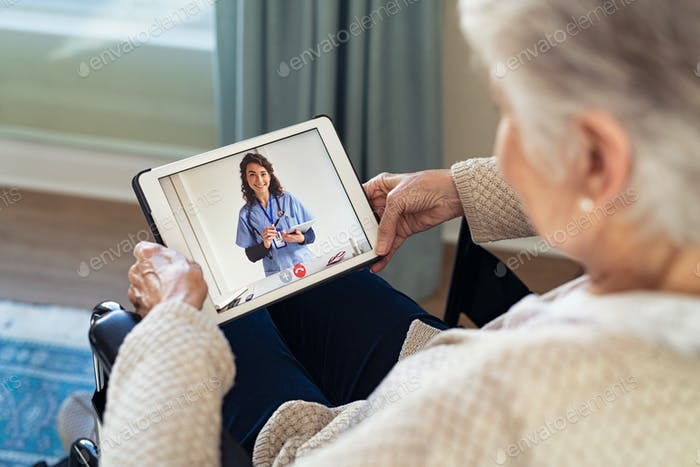 Doctor on video call with disabled senior patient