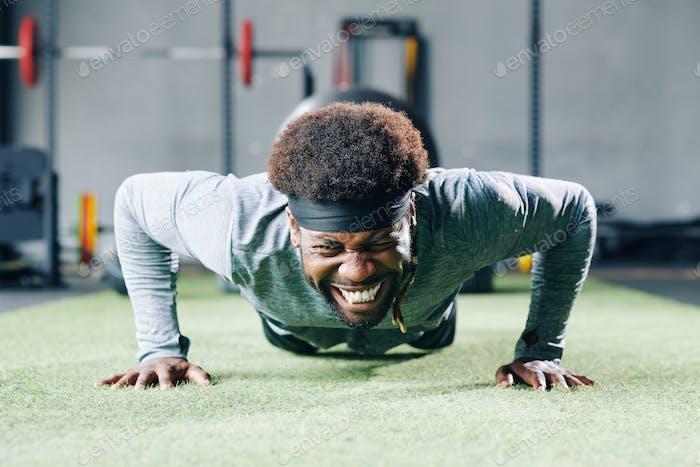 Man struggling with doing push-ups
