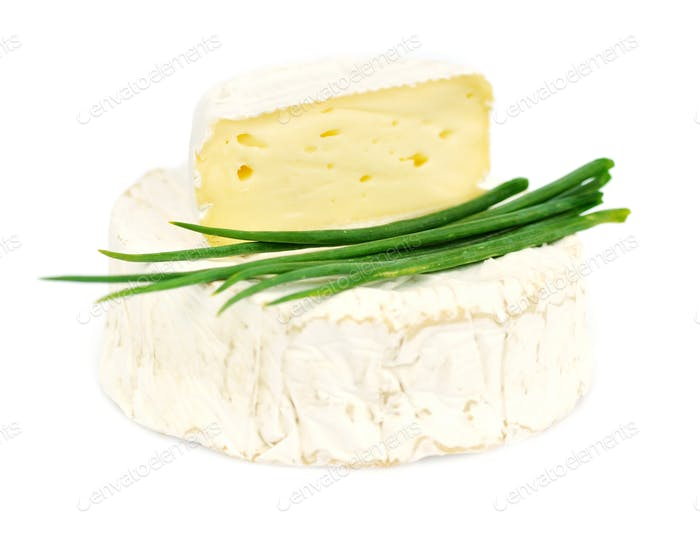 Round camembert cheese with green onion on white background