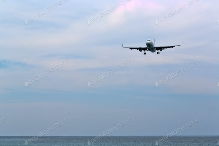 Passenger liner over the beach and the sea