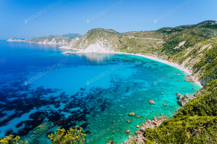 Myrtos beach with azure blue sea water in the bay. Favorite tourist visiting destination place at