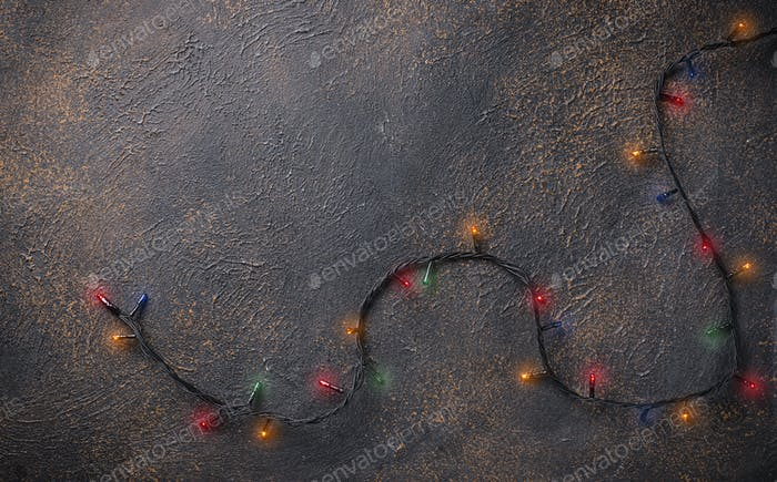 Christmas garland lights on dark background