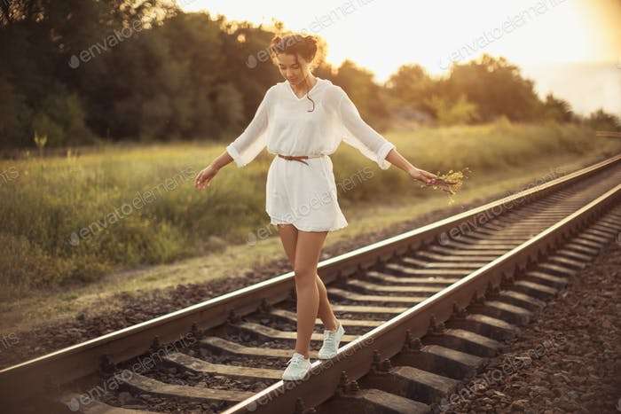 Girl Balancing on Train Rail