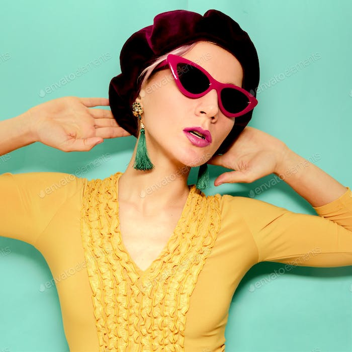 Model in fashion accessory beret and sunglasses. Vintage yellow
