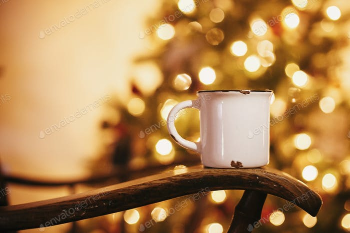 Mug with hot drink on old wooden chair
