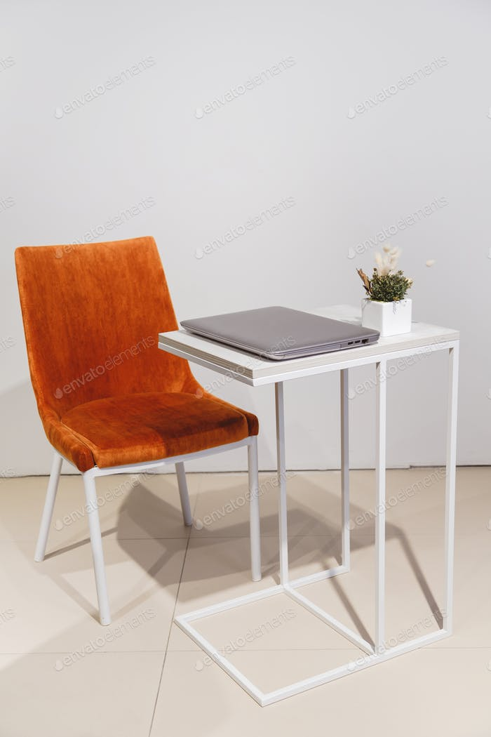 Minimalist lifestyle. laptop on coffee table side view with copy space in background