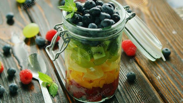 Fresh fruits in glass jar