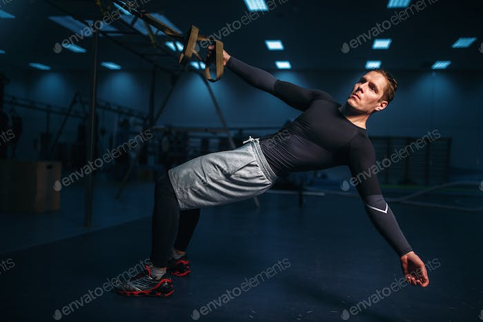 Male athlete on training, stretch workout