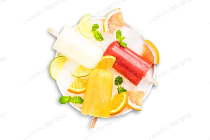 Homemade popsicles with natural juice, isolated on white