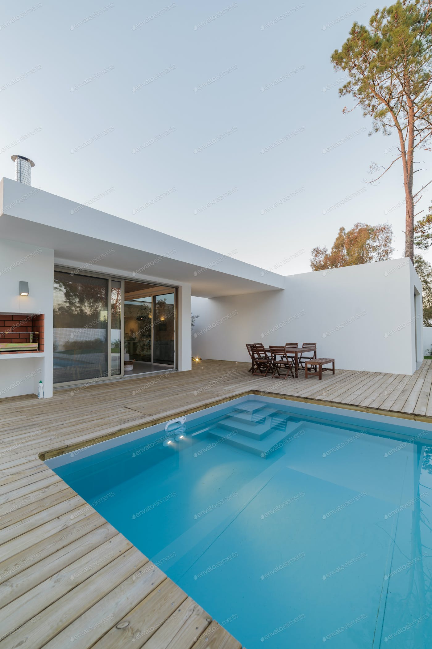 Modern House With Garden Swimming Pool And Wooden Deck Photo