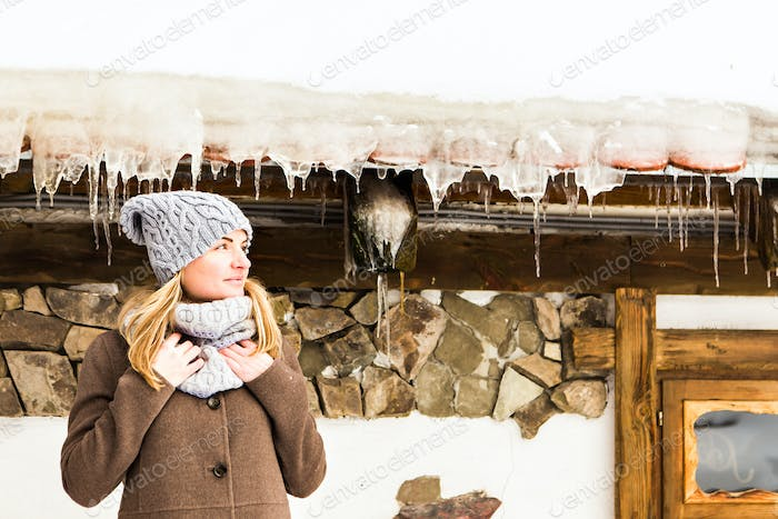 young woman near the house of Santa Claus