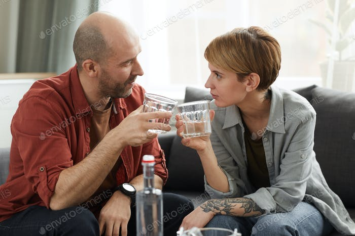 Couple drinking scotch and talking