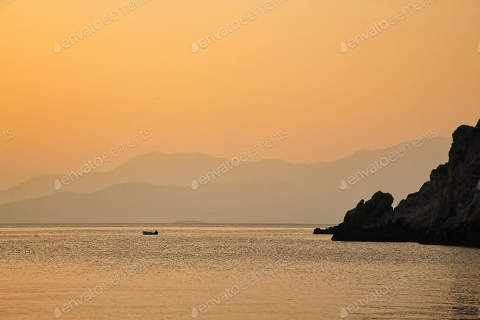 Fisherman Boat on sea during golden sunset, Greece
