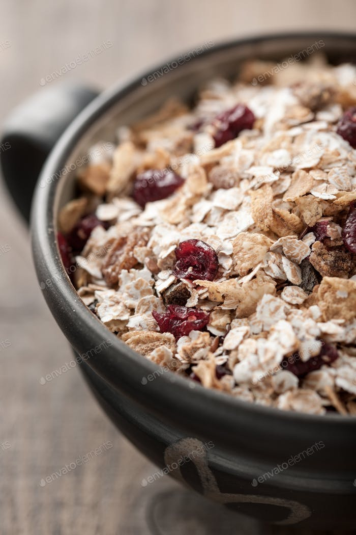 Organic muesli with berries in a bowl