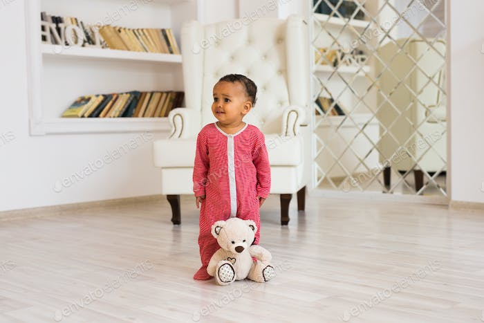 african american baby boy with teddy bear